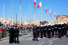 Freeedom day celebrations, Vittoriosa. Freedom day celebrations with military personnel and a brass band by the Freedom Day monument, Vittoriosa, Malta, Europe Stock Image