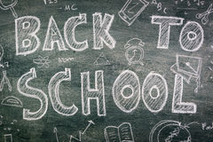 .Freehand drawing Back to school on chalkboard. Freehand drawing Back to school on chalkboard Royalty Free Stock Photography