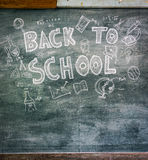.Freehand drawing Back to school on chalkboard. Freehand drawing Back to school on chalkboard Royalty Free Stock Photo