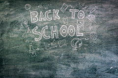 .Freehand drawing Back to school on chalkboard. Freehand drawing Back to school on chalkboard Royalty Free Stock Photos