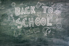 .Freehand drawing Back to school on chalkboard. Freehand drawing Back to school on chalkboard Stock Photo