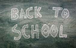 .Freehand drawing Back to school on chalkboard. Freehand drawing Back to school on chalkboard Stock Image