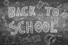 Freehand drawing Back to school on chalkboard ,Filtered image pr. Ocessed black and white effect Royalty Free Stock Photo