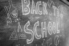 Freehand drawing Back to school on chalkboard ,Filtered image pr. Ocessed black and white effect Stock Image