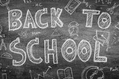Freehand drawing Back to school on chalkboard ,Filtered image pr. Ocessed black and white effect Royalty Free Stock Image
