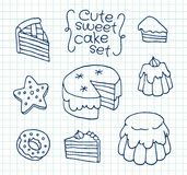 Freehand drawing cute cake on sheet of exercise Royalty Free Stock Photos