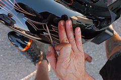 Freehand pin striping. Painter decorates a motorbike with freehand pinstriping at motorcycle rally Motorigadena 2012 on July 08, 2012 in Forli, Italy Stock Images