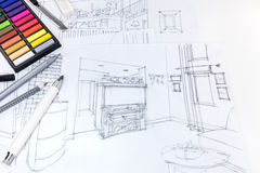 Freehand sketch of living room interior and drawing tools on designers desk. Freehand sketch of living room interior and drawing tools on designers workplace royalty free stock image