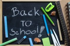 Freehand writing Back to school letters on chalkboard with Schoo Stock Images