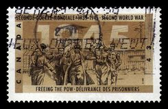 Freeing the prisoners of war POW. CANADA - CIRCA 1995: A stamp printed in Canada shows freeing the prisoners of war POW, series 50th Anniv. of Second World War royalty free stock photo
