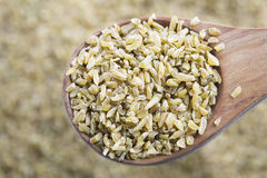 Freekeh in Wooden Spoon Royalty Free Stock Photos
