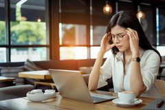 Free Freelance Asian Woman Headache Tired,stess Or Deadline With Digital Laptop Royalty Free Stock Photography - 159733007