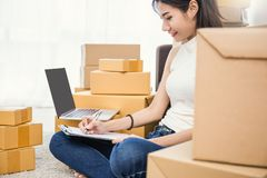 Freelance asian woman working with box at home concept royalty free stock photo