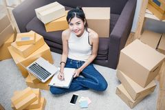 Freelance asian woman working with box at home concept Stock Image