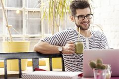 Freelance brunch at coffee shop Royalty Free Stock Image