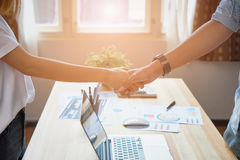 Freelance businessman are shaking hands after successful negotiations in business, The concept of business advancement through Royalty Free Stock Photo