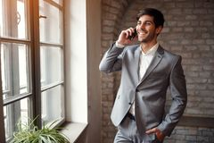Freelance businessman in suit with smartphone Royalty Free Stock Photo
