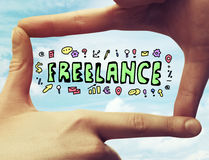 Freelance concept. Creative sketch framed with fingers on sky background. Freelance concept Royalty Free Stock Images