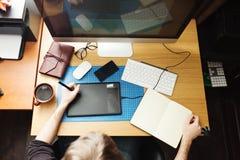 Freelance developer and designer working at home. Man using desktop computer Stock Image