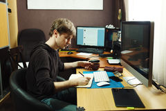Freelance developer and designer working at home Royalty Free Stock Photos