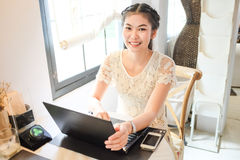 Freelance e business asian women using laptop computer in coffee Stock Image