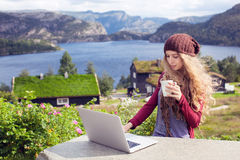 Freelance girl working on laptop in nature. And beautiful landscapes Stock Photos