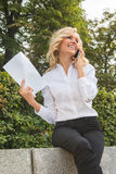 Freelance lady speaking over mobile phone oudoors Stock Images