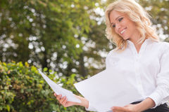 Freelance lady working oudoors Royalty Free Stock Images
