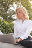 Freelance lady working oudoors Royalty Free Stock Photography