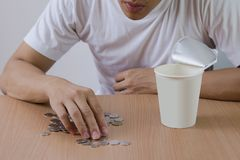Freelance man not have salary count the coins, stressed out Stock Image