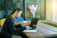 Freelance man working on laptop computer in home office Stock Photos