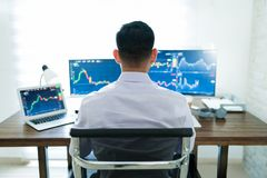 Free Freelance Online Trader Working At Desk Stock Image - 160368951