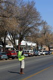 Freelance parking attendant. Parys, South Africa - a freelance parking attendant assists motorist to find parking in order to generate some income from tips Royalty Free Stock Photo