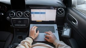 Freelance photographer works remotely from car stock footage