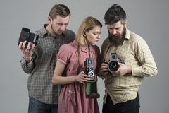 Freelance photographers. Paparazzi or photojournalists with vintage old cameras. Group of people with retro cameras. Photography studio. Retro style women and stock photos