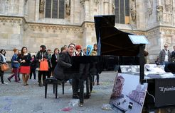 Freelance pianist is playing his grand piano during Carnival celebration at Duomo. Stock Image