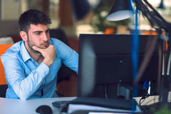 Freelance programmer working in startup office. Freelance young programmer working in startup office Stock Images