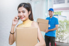 Freelance woman and man working with boxes at home concept,. Start up small business entrepreneur SME or freelance women and men working at home concept, Young royalty free stock photography