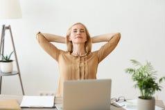 Freelancer Resting After Work, Holding Arms Behind Head. Freelance Woman Resting After Work, Holding Arms Behind Head royalty free stock image
