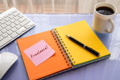Freelance word on sticky note at workspace Royalty Free Stock Images