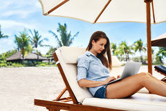 Freelance Work. Business Woman Using Computer On Beach. Online Work Stock Photos