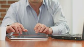 Freelance worker hands typing, sending e-mail from tablet PC. Stock footage stock video footage