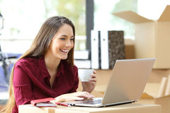 Freelance working during office relocation Stock Images