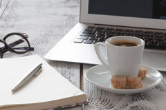 Freelance Workplace with laprop and coffee. Freelance Workplace with laptop and coffee on table Stock Photography
