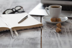 Freelance Workplace with laptop and coffee on table Royalty Free Stock Photos
