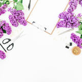Freelance workspace with clipboard, notebook, scissors, lilac and accessories on white background. Flat lay, top view. Beauty blog. Freelance workspace with Royalty Free Stock Photos