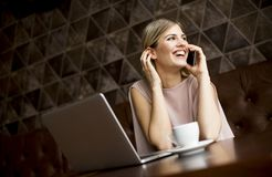 Young freelance woman in cafe Royalty Free Stock Photos
