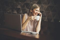 Young freelance woman in cafe Stock Photos