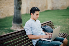 Freelancer asian man working on his laptop  working in the city Stock Photo