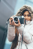 Freelancer asian photographer exploring in cold weather. Young photographer in winter coat Stock Images